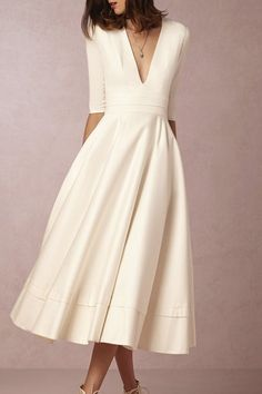 A TAILORED SHIRTDRESS  The chicest city-hall bride we ever did see.  BHLDN ($2,900)