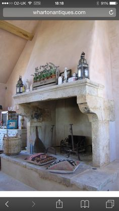 This French stone fireplace was purchased from Wharton Antiques for a large, privately-owned property recently built in the Cotswolds.Pictured here is the kitchen fireplace complete with a raised stone hearth that doubles as relaxed seating in front. Fireplace Logs, Inglenook Fireplace, Rustic Fireplaces, Farmhouse Fireplace, Fireplace Surrounds, Fireplace Design, Fireplace Ideas, Fireplace Inserts, Fireplace In Kitchen