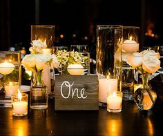 10 Stunning Centerpieces For Your Wedding Reception | Multiple glass vases on one table. I like it! Simple, yet beautiful!