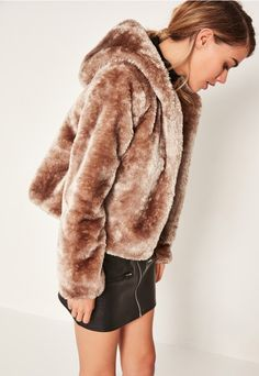 we love a faux fur coat here at missguided and this taupe shade with an oversized hood is top of our wish list.