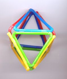 Building shapes with bendable drinking straws.