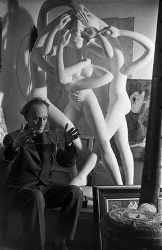 "Émile Savitry - Victor Brauner in his studio, with his sculpture ""Conglomeros"", Perrel street, Montparnasse, Paris, 1946"