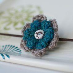 Jade Green Bird Crochet Flower on Skinny Elastic. $8.00, via Etsy.