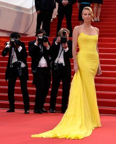 Charlize Theron shone bright at the Mad Max: Fury Road premiere in a yellow structured Dior Couture strapless gown that was finished with a long chiffon train. Her diamond jewels were big on the sparkle.