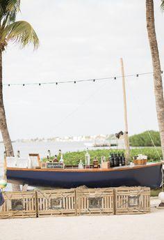 Palm trees, beach bar, blue sailboat // Kristen Browning Photography