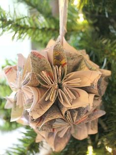 Recycle your old paper maps by turning them into ornaments! Simply follow this blogger's surprisingly easy folding technique, then loop with a ribbon to finish. Get the tutorial at Chic California.   - CountryLiving.com