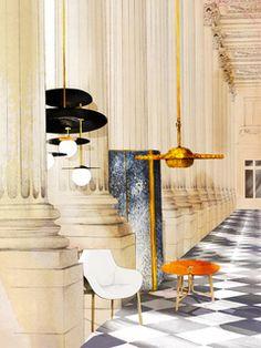 Rome: Le Palazzo Fendi par Dimore Studio à Rome Silvia Venturini Fendi pose dans le salon devant des luminaires (Dimorestudio) en panneaux de métal doré parfois recouverts de cuir. Derrière, dans les panneaux des boiseries a été tendu un satin de coton (Dedar). 6   AD Magazine