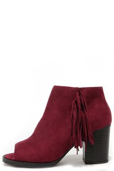"""From what it sounds like, you love a chic bootie ... so go ahead and take the Make a Peep Dark Burgundy Peep Toe Fringe Booties for a spin! Soft vegan kid suede sculpts a peep toe upper decorated with a row of dangling fringe at the outstep. 4"""" black zipper at the instep allows for easy access atop a cushioned insole and 3"""" stacked heel (including tip). Nonskid felted rubber sole. Available in whole and half sizes. Measurements are for a size 6. All vegan friendly, man made materials…"""