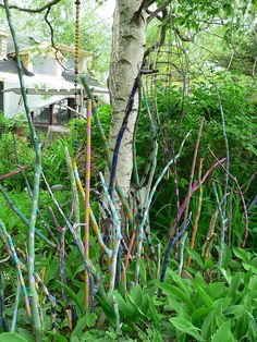 painted sticks--maybe I can use all those bamboo sticks I have