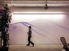 A Facebook employee walks past a mural by Matt Shlian. Natalie Keyssar/WIRED | WIRED.com