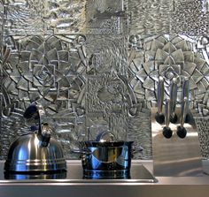 Recently finished project: DXU aluminium tiles on a kitchen wall. We have mixed the Lotus and Caldera patterns here for a unique display. by dxutiles
