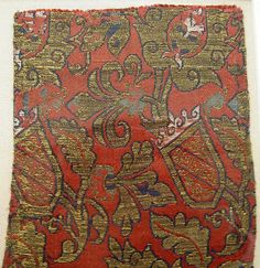 Fragments Date: 15th century Geography: Spain, Granada Culture: Islamic Medium: Silk, metal-wrapped thread; lampas Dimensions: Textile a: L. 11 1/2 in. (29.2 cm) W. 6 1/8 in. (15.6 cm) Textile b: L. 11 1/8 in. (28.3 cm) W. 5 1/2 in. (14 cm) Mount: L. 16 in. (40.6 cm) W. 22 in. (55.9 cm) Classification: Textiles-Woven