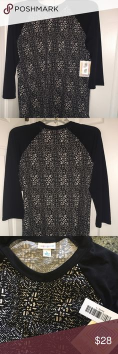 LuLaRoe Randy Ladies Tee Shirt NWT LuLaRoe Randy ladies tee shirt - NWT.  Very flattering black and white pattern with all black sleeves that come just below your elbows.  Extremely comfortable! LuLaRoe Tops Tees - Long Sleeve