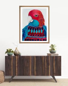 This is a beautiful whimsical take on our beloved feathered friends. This will instantly  inject colour to any living space Big Red is our highly social, intelligent parrot. He is a reflection of his family and often imitates their behavior.   All Lelly Lou art prints are printed on high-quality matte paper, signed & numbered  by Lelly herself and embossed with Lelly Lou signature stamp. Limited edition of 250 & available in 3 sizes