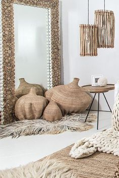 We love the organic, natural detail in Takke Mirror 😍🌿👉🏼 made from natural teak wood branches no mirror is the same! 🙌🏼 🍃Also featuring Uniqwa's Bulawayo Garlic Gourd Basket's, Primitive Pendant Light's, Kariba Side Table and #vachtvanvilt 100% animal friendly sheep rug ❤️✔️