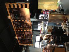 Pallets menu board at Just Love Coffee Roasters.