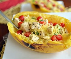Lighten up your springtime meals by subbing spaghetti squash for heavy pasta. This margherita spaghetti squash dish with chicken is perfect warm or cold.