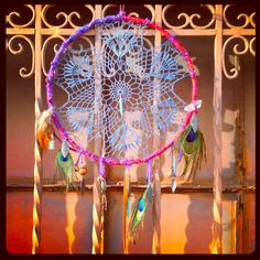 Gypsy Caravan. Handmade Vintage Lace Doily Dream Catcher in Berry & Deep Periwinkle w Peacock Feathers, Bells, Quartz Crystal, Wooden Bead. $68.00, via Etsy.