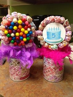 This was a centerpiece for my daughter's 5th birthday. You will need: coffee cans,lollipop wrappers,styrofoam,stick gumballs,lolliopops and feathers