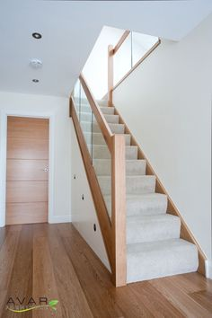 scandinavian furniture Steel and wood stairs with a glass handrail lead up to the second floor of this modern house. Staircase Storage, House Staircase, Stair Storage, Staircase Ideas, Stair Bannister Ideas, Stairs And Hallway Ideas, Banisters, Cube Storage, Home Stairs Design