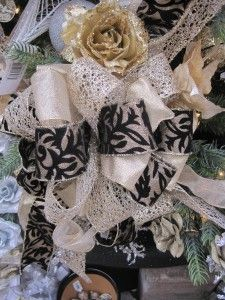 Don't miss this vogue Parisian themed bow from your Christmas Shop at Stauffers of Kissel Hill Garden Centers. This Pariasian Stroll theme is created in gold, silver and white with a fashionable touch of black. Ooh La La! www.skh.com