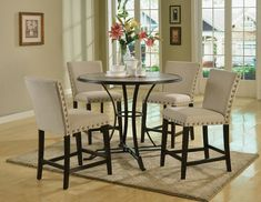 """5 pc Byton antique light oak finish 45"""" round wood and black frame counter height dining table set.  This set includes the table with 4 chairs.  Table measures 45"""" Dia. x 36"""" H.  Chairs measure 40"""" H to the back.  Some assembly required."""