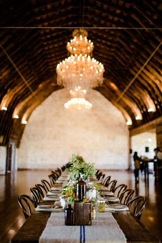 A long table fills a large space in a dramatic way.  From last year's Contigo catering lunch with Loot Vintage Rentals; Photo by Sweet Caroline Photography.  #BrodieHomestead #eventvenue #table #decor #weddingideas #austin #barn #chandelier