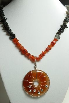 Handmade Healing Crystal Necklace: Black Obsidian and Red Orange Carnelian and Silver Wire Wrapped Pendant. $35.00, via Etsy.