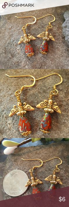 🆕 handmade earrings Beautiful gold detailed angel earrings.  I created these earrings using gold wings and findings with teardrop multi colored red gemstone beads. Gold earring wire.   Bundle discount available. Nonsmoking home. All reasonable offers accepted. handmade  Jewelry Earrings