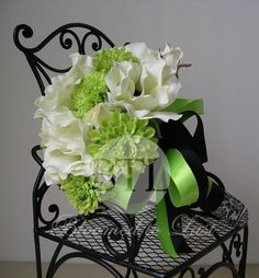 This bouquet would be perfect for a Halloween Wedding.Black, White Anemone & Lime Green Pom Mums Wedding BOUQUET. $105.00, via Etsy by www.bloomedtolast.com