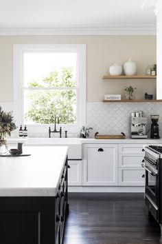 Exquisite black and white kitchen is equipped with a black center island topped . Exquisite black and white kitchen is equipped with a black center island topped with a thick honed white marble countert. White Kitchen Backsplash, Kitchen Tiles, New Kitchen, Country Kitchen, Kitchen Decor, Backsplash Ideas, Kitchen White, Backsplash Tile, Kitchen Colors