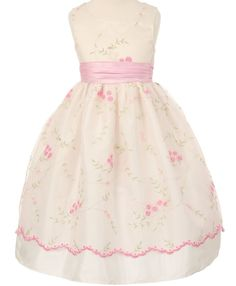 Lena - Pink Emboidered Flower Girl DressStyle CC1089-11 Pink Embroidered Flower Girl Dress This light pink embroidered dress has a pretty flower decor with scalloped embroidered trim. The satin is wedding quality ivory satin. The apron style is attached to the dress and not removable.