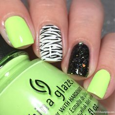 Zebra nail art with a pop of green!