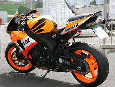 Learn to ride a motorcycle- preferably a Repsol Orange - Honda CBR1000RR