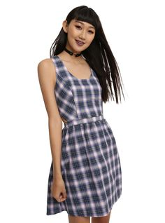 "This dress is just begging to be added to your wardrobe. This super cute skater skirt comes in a pastel plaid, with a rounded neck, princess seams at the bust, side cut-out detailing at waist, that gives way to a circle skirt with pockets, and ends with a back zipper.<div><ul><li style=""list-style-position: inside !important; list-style-type: disc !important"">100% cotton</li><li style=""list-style-position: inside !important; list-style-..."