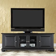 """This 60"""" TV Stand is the perfect entertainment furniture for your living space. It effortlessly accommodates most standard 60"""" television sets. This TV stand is designed to complement your home decor and even provide storage for your electronic equipment. The compact size of the TV stand allows mobility and helps in saving floor space. Regardless of its size, the hardwood and veneer construction makes this stand robust and durable. It has a maximum weight capacity of up to 200 lbs. ..."""