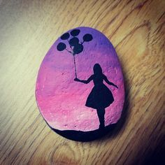 Painted rock.... reminds me of Emma from Miss Peregrines Home For Peculiar Children  :)