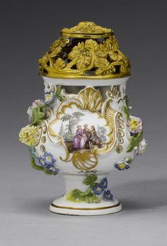 A pair of small Meissen ormolu-mounted pot-pourri vases and a cover circa 1750