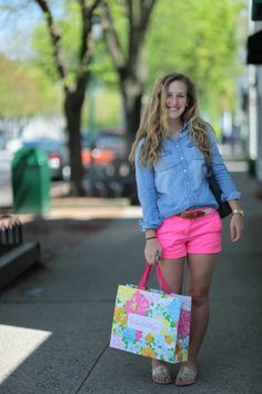 Neon pink shorts with a denim shirt