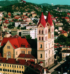 "The early was crowned as ""The Litter with the style of architecture. Qingdao, Romanesque, World War Ii, Big Ben, Catholic, Cathedral, Germany, Architectural Styles, Saint John"