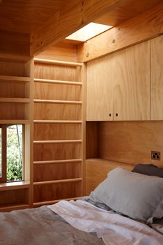CCCA - Hut on Sleds. Dr: built-in joinery around bed, see how it frames window. (No insulation?).