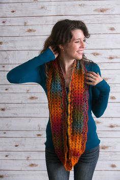 Autumn Sunrise Infinity Scarf - With all the colors of an autumnal sunrise contained in one skein of yarn, let the yarn create subtle color shifts for you as you work through an easy crochet pattern. End off with a shell edging on either side of the center panel for a lovely finishing touch. From the October 2015 issue of I Like Crochet