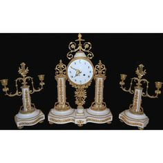 Here is a superb French Louis XVI three piece bronze garniture clock set with a flawless white marble. Excellent bronze casting detail gives this set a noble look. Having an enameled Roman Numeral dia...  price