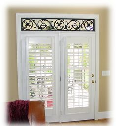love the iron work on transome and plantation shutters on doors