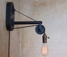 Vintage Industrial Pulley Sconce Lamp. Plug by IroncladIndustrial, $229.00