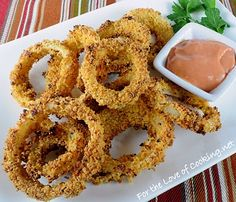 Baked Onion Rings      2 sweet yellow onions, sliced into thick rings     1/2 cup of flour     Sea salt and freshly cracked pepper, to taste     1 egg     3 tbsp milk     1 1/2 cups of Italian seasoned panko crumbs     Cooking spray