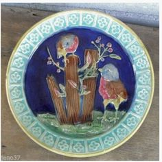 Eureka Pottery. USA. Rare Majolica plate with birds in a night landscape.