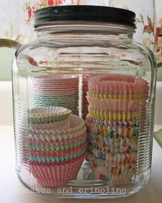 I already store my mini wrappers in clear containers. Will do this for all of them on shelves. Find vintage looking jars.