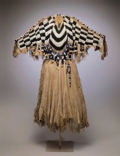Yakama two hide dress.... covered with pound beads and dentalium shells (a primitive form of money actually).