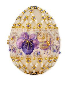 Cross stitch band beaded onto an egg